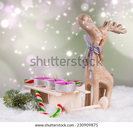 Christmas decoration, reindeer on snow with abstract background  - stock photo