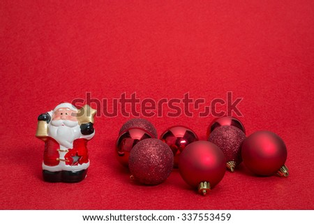 Christmas decoration, Santa Claus, Christmas ball on the red blur background - stock photo
