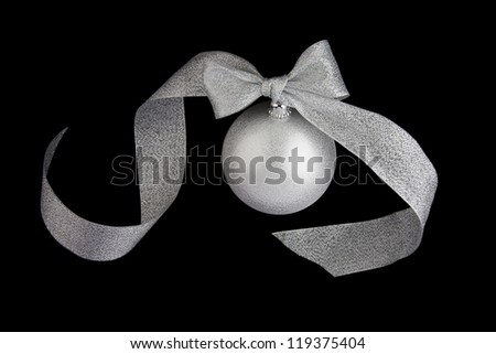 Christmas decoration silver ball with silver ribbon bow on black