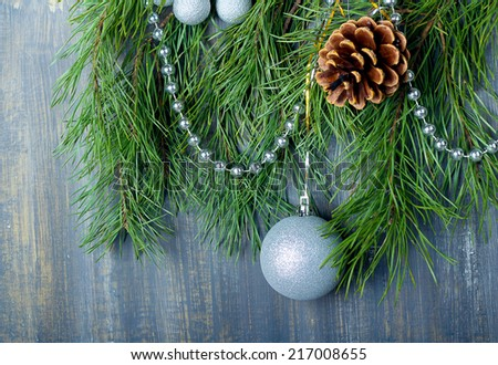 Christmas decoration: silver balls and cones over painted grey board