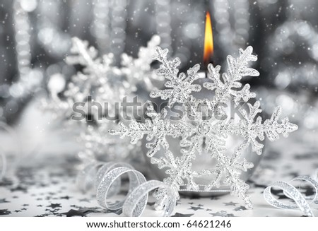 Christmas decoration, silver holiday background with candle & snowflake - stock photo