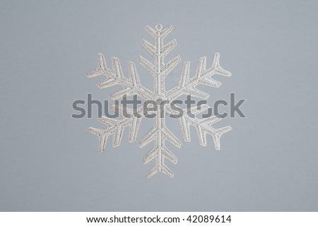 Christmas decoration silver snowflake on gray background