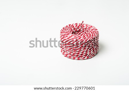 Christmas decoration string red and white reel, isolated on white background