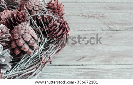 Christmas decoration, twigs and pine cones - stock photo