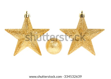 Christmas decoration, two gold glitter stars and a bauble isolated against white - stock photo