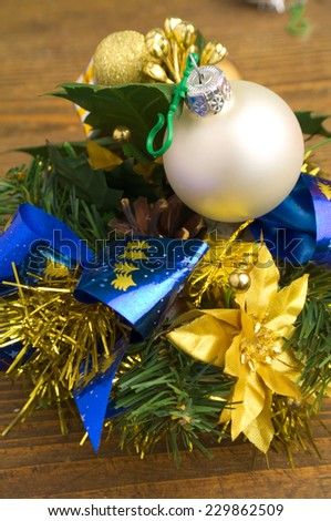 christmas decoration with a bauble and fir twig - stock photo
