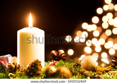 Christmas decoration with a burning candle