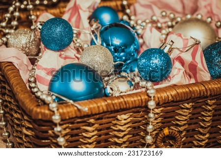 Christmas decoration with balloons in the box on warm background - stock photo