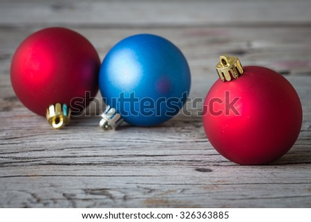 Christmas decoration with bauble ball on wooden table background, selective focus, rustic style  - stock photo