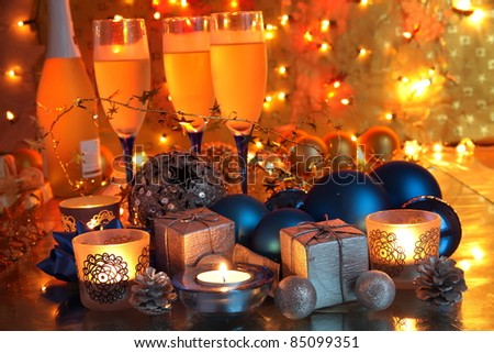 Christmas decoration with bauble,gifts,candle lights and gold background with twinkle lights. - stock photo