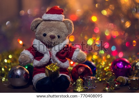 Christmas decoration with Bear wearing Santa Claus costume