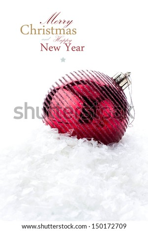 Christmas decoration with  big red bauble and snow  (with easy removable sample text) - stock photo