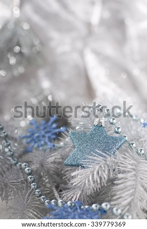 Christmas decoration with blue star bauble, blue snowflakes and chain. - stock photo
