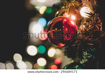 Christmas decoration  with blurred lights bokeh defocus  vintage tone  - stock photo