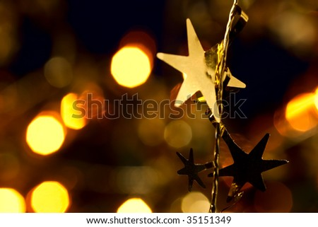 Christmas decoration with blurred lights in background, shallow DOF - stock photo
