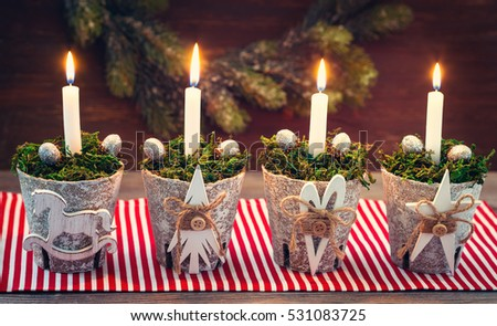 Christmas decoration with candle and silver cones.