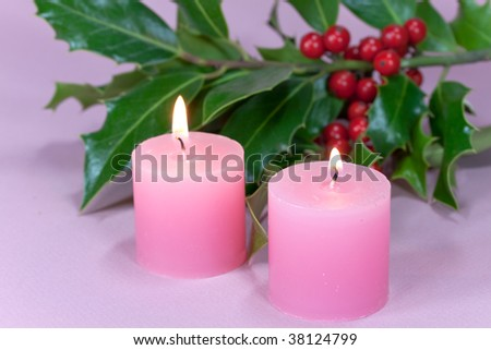 christmas decoration with candle light,holly leaves and berries