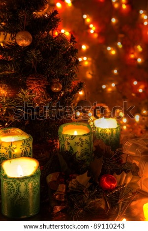 christmas decoration with candle lightschristmas tree baubles an twinkle lights on background