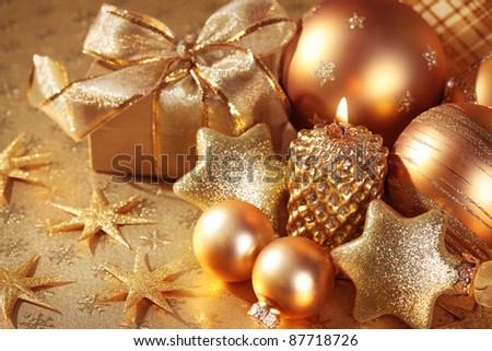 Christmas decoration with candle on golden background - stock photo