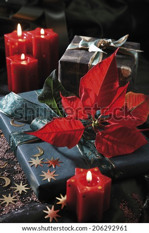 Christmas decoration with candles and christmas presents - stock photo
