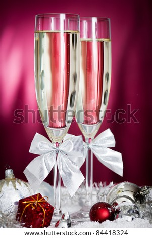 christmas decoration with christmas ball ornaments and champagne glasses