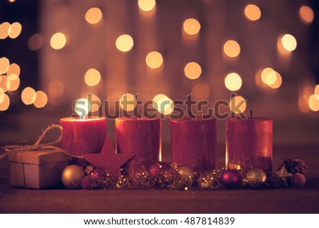 christmas decoration with christmas bauble and candle for advent season one candle burning