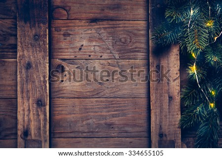 Christmas decoration with festive garland on a wooden surface. Christmas background with copyspace - stock photo
