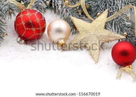 Christmas decoration with fir branch,Christmas ball and star,closeup. - stock photo