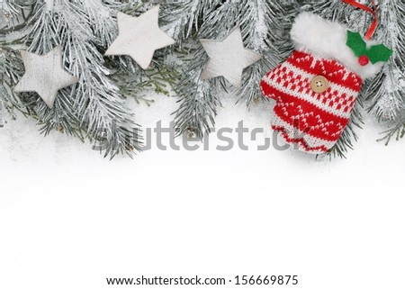 Christmas decoration with fir branch, Christmas star and glove. - stock photo