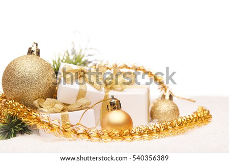 Christmas decoration with fir branch, gift boxes, golden balls and garlands lying on snow on a white background.  New year and Christmas background with copy space for text. Greeting card.