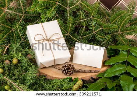 Christmas decoration with fir branches, mistletoe, wood and gifts - still life, copy space