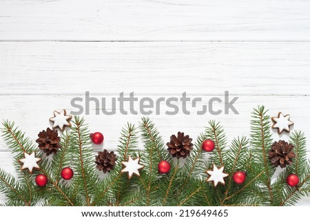 Christmas decoration with fir tree and Christmas cookies - stock photo
