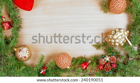 Christmas decoration with fir tree  and ornamentals gifts or presents on white wood board with copyspace , blank place for text and advertising, greeting card for New Year's holidays