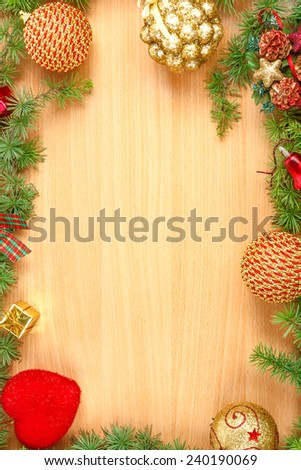 Christmas decoration with fir tree  and ornamentals on wood board with copyspace , blank place for text and advertising, greeting card for New Year's holidays - stock photo