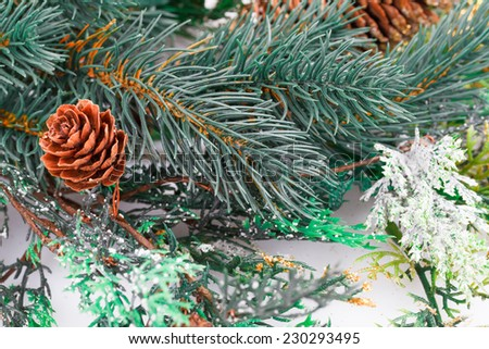 Christmas decoration with fir-tree branch and cones. - stock photo