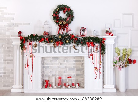 Christmas decoration with fireplace in the room - stock photo