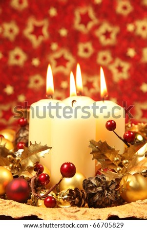 Christmas decoration with four candles on red Christmas background. Shallow DOF, copy space - stock photo
