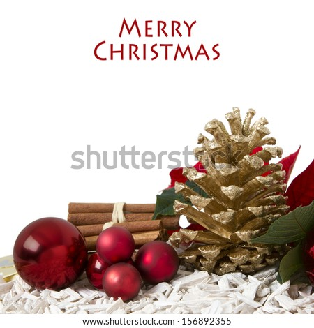 Christmas decoration with glass balls, pine cone and spices on white background - stock photo