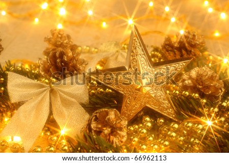 Christmas decoration with golden ornaments and Christmas lights - stock photo
