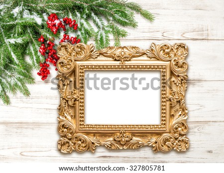 Christmas decoration with golden picture frame on wooden background. Winter holidays - stock photo