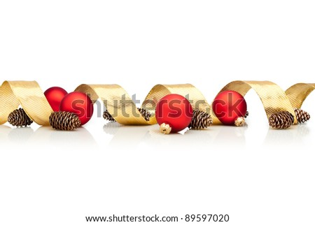 Christmas decoration with golden ribbon, cones and red glass balls isolated over white background - stock photo
