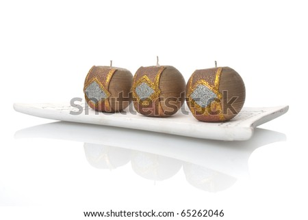 Christmas decoration with golden wax candles on a white background.