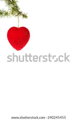 Christmas decoration with green pine or fir and red heart ornament for Christmas tree. Holiday decorations isolated on white background. Empty or copy space for holiday greeting card - stock photo