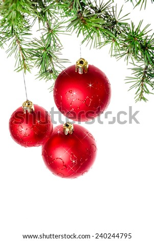 Christmas decoration with green pine or fir and red round ball ornaments for Christmas tree with sparks. Holiday decorations isolated on white background. Empty or copy space for holiday greeting card - stock photo