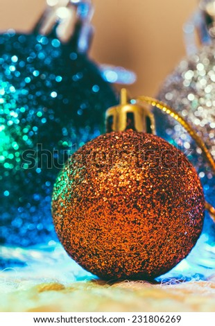 Christmas decoration with multicolor balloons on warm background - stock photo
