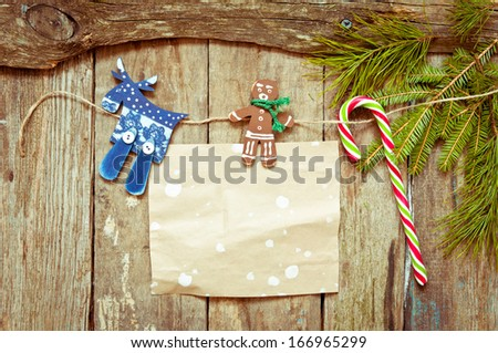 Christmas decoration with old paper on a wooden background