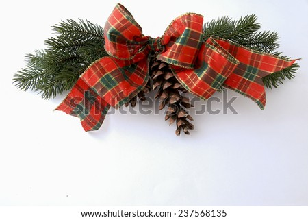 Christmas decoration with pine branches and red ribbon - stock photo