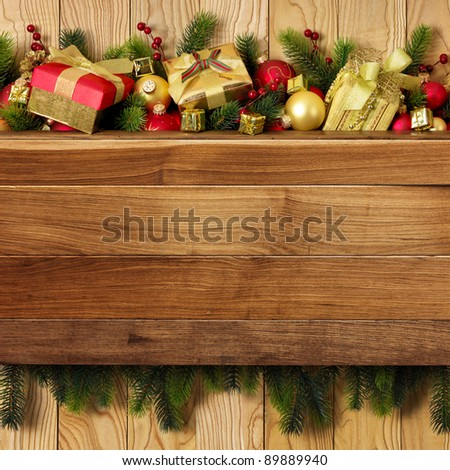 Christmas decoration with presents on wood board - stock photo