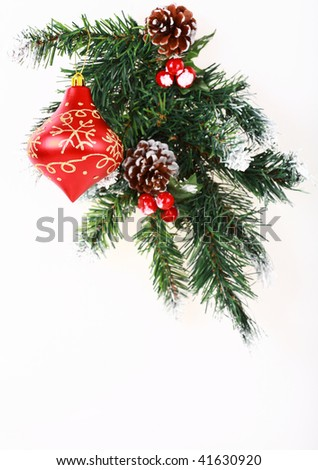 Christmas decoration with red balls on white background with copyspace for your text