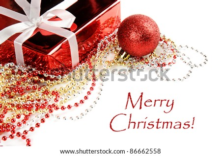 Christmas decoration with red gift box and shiny tinsel with text